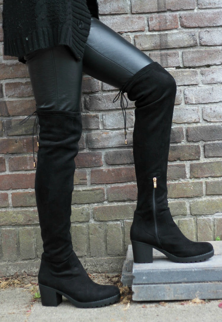 Over the knee boots in all-black outfit